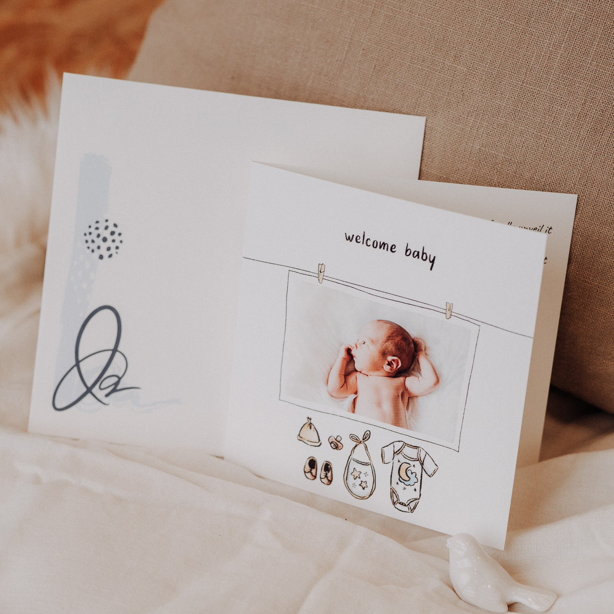 baby clothes drawing announcement