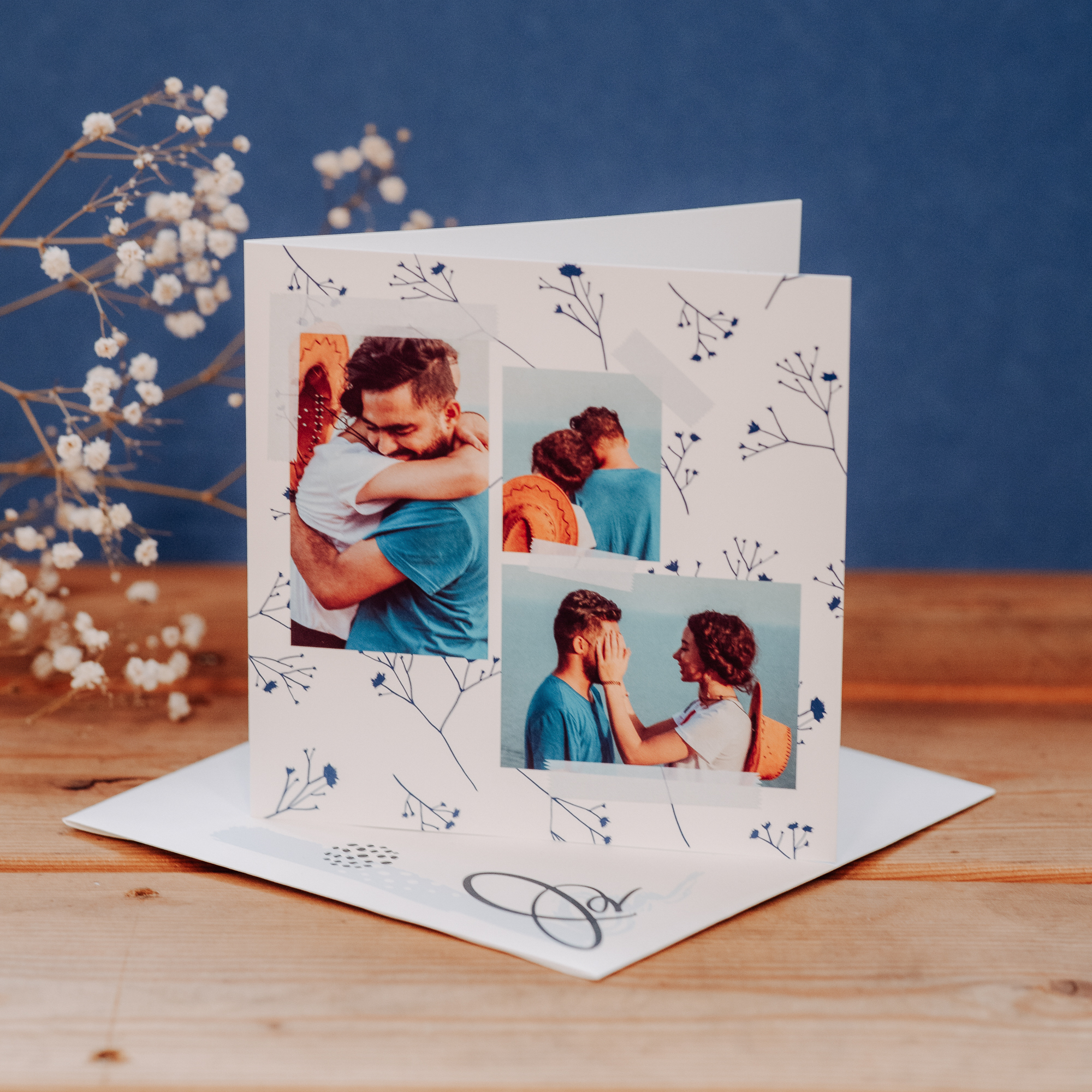 card with couple and three pictures on blue background