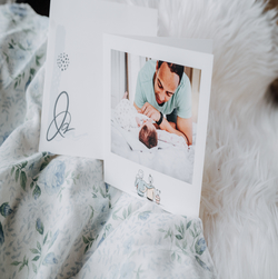 card with father and baby placed on fabric