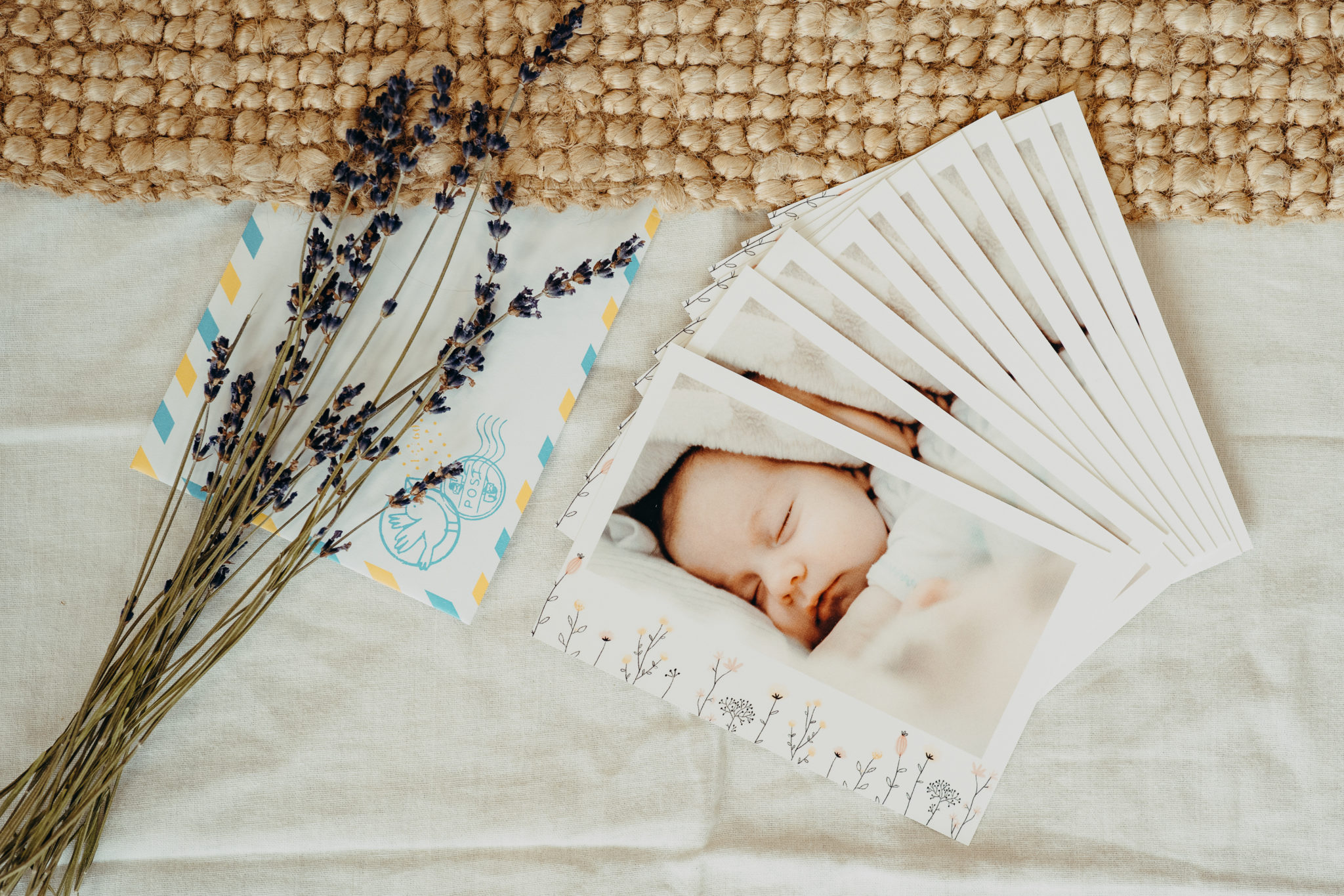 set of birth announcement cards with flowers